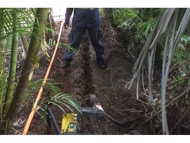 Trenching for electrical cable - Rogers Little Loaders. - 1