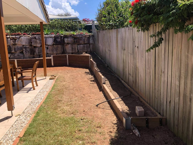 Concrete sleeper retaining wall - Front. - Rogers Little Loaders - 1