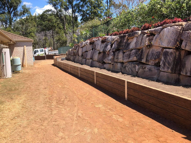 Concrete sleeper retaining wall - Front. - Rogers Little Loaders - 2
