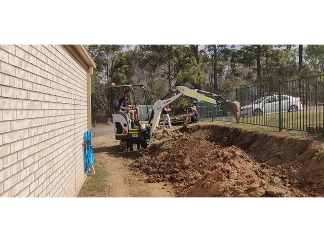 Concrete sleeper retaining wall - Front. - Rogers Little Loaders - 3