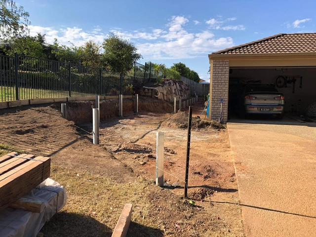 Concrete sleeper retaining wall - Front. - Rogers Little Loaders - 4