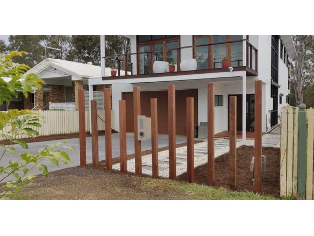 Landscaping in Lota - Paving, concrete driveway, gardens and feature fence - 2