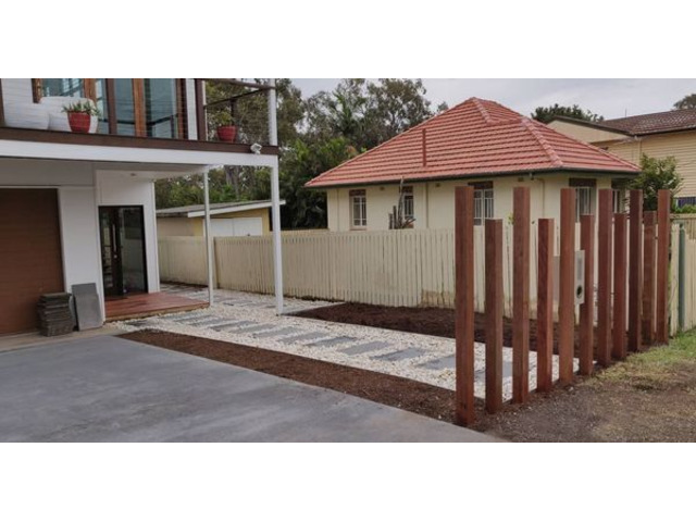 Landscaping in Lota - Paving, concrete driveway, gardens and feature fence - 3