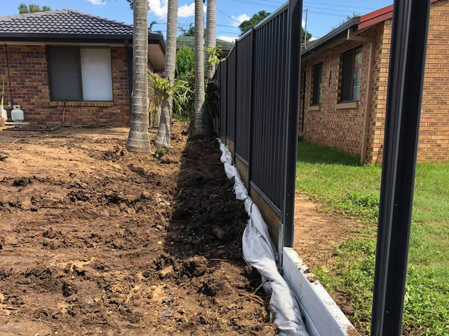 Massive yard raise into an oasis -Retaining and Fencing - 6
