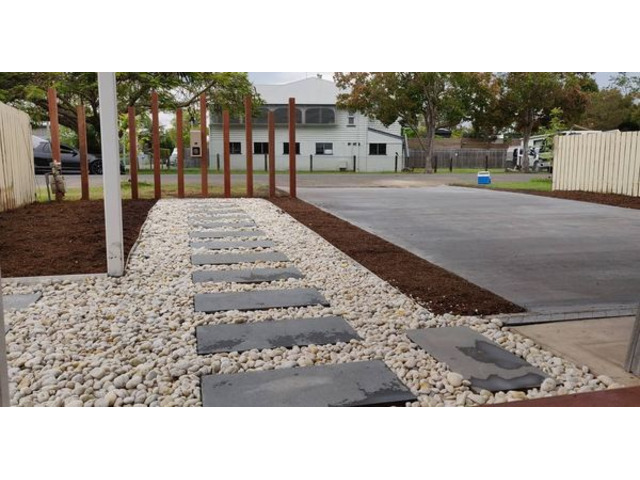 Landscaping in Lota - Paving, concrete driveway, gardens and feature fence - 4