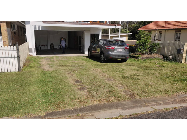 Landscaping in Lota - Paving, concrete driveway, gardens and feature fence - 7