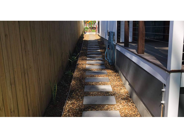 Landscaping in Lota - Paving, concrete driveway, gardens and feature fence - 8