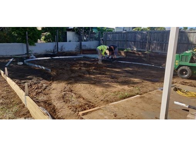Retaining the entire backyard with geomesh on April 10 - Rogers Little Loaders. - 2