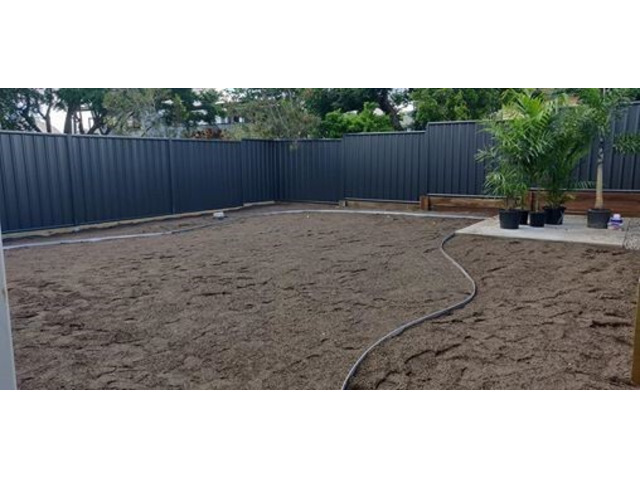 Retaining the entire backyard with geomesh on April 10 - Rogers Little Loaders. - 3